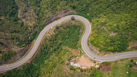 Top view asphalt road on the hill in Phetchabun province, Thailand. Aerial view from flying drone. Stock Photo