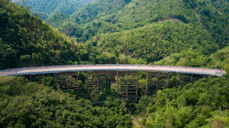 Pho Khun Pha Muang bridge. The high concrete bridge in Phetchabun province, Thailand. Connect northern to northeast. Aerial view from flying drone.