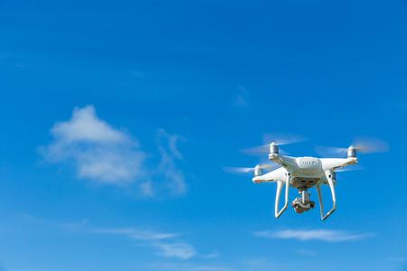 Flying drone quadcopter with digital camera on blue sky background Reklamní fotografie