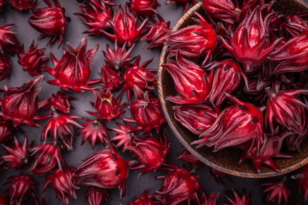 Pile of fresh red Roselle use for herb or food concept Imagens