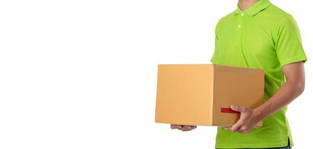 Asian delivery man carry brown parcel or cardboard boxes isolated on white background. Express and delivery concept Zdjęcie Seryjne