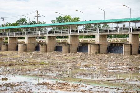 A lot of waste in the river and stuck near the main gate of dam Foto de archivo