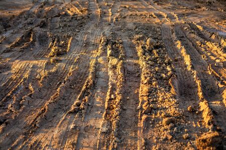 Wheel track on wet soil or mud. Dirty soil on the road after raining