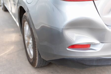 Close up backside of new silver car get damaged by accident. Car repair and insurance concept 版權商用圖片