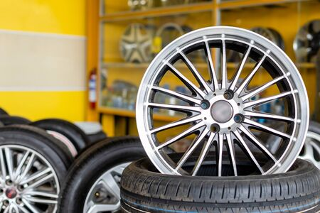 New silver mag wheel. Magnesium alloy car wheels and pneumatic tires in store or service center Stock fotó