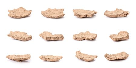 Piece of cracked earth peeling from the river in drought season isolated on white background