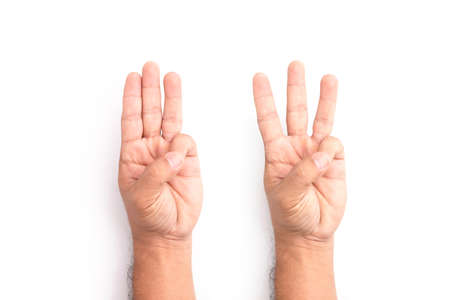 Hand showing three finger symbol isolated on white background Stockfoto