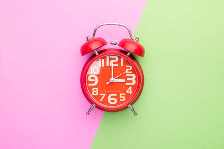 Top view old red alarm clock on bright color background Stockfoto