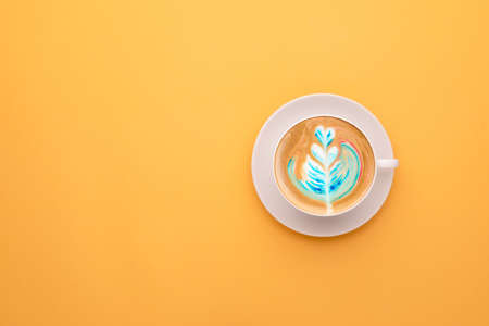 Top view white cup of hot Latte art coffee on yellow background Stockfoto