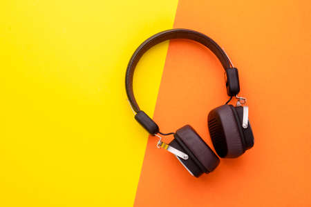 Top view black Headphone or Headset on bright color background. Copy space for text or design Standard-Bild