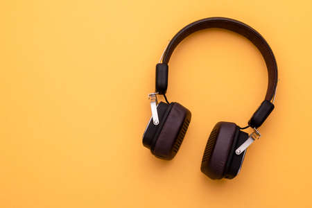 Top view black Headphone or Headset on bright color background. Copy space for text or design Stockfoto
