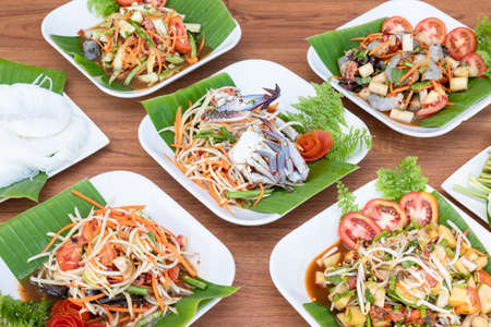 Close up set of several papaya salad and spicy salad on the table. Thai style food concept