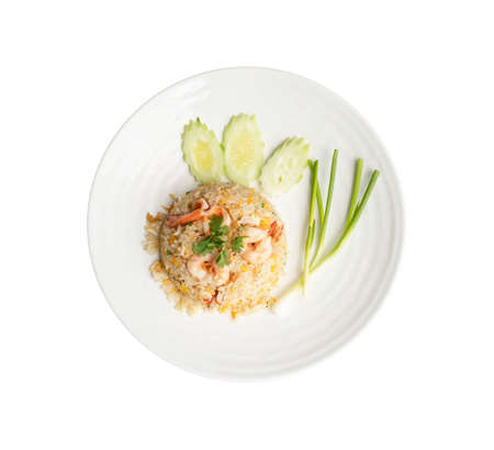 Top view. Fried rice with shrimp in round white dish isolated on white background. Thai Food concept