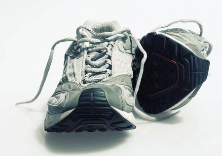 rigorous: Un paio di scarpe da ginnastica isolato  Archivio Fotografico