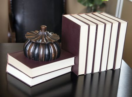 A row of books on a desk. photo