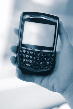Holding Pda cell phone  Stock Photo