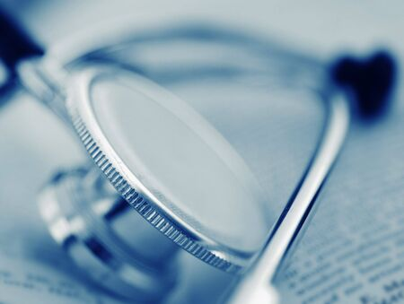 medical condition: A medical tool - stethoscope on a open book
