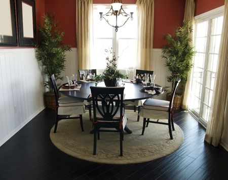 Beautiful formal dining room area with rich dark hard wood flooring