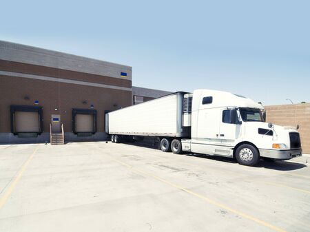 Heavu goods truck leaving warehouse