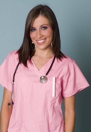 stephoscope: Nurse in pink scrubs with clip board