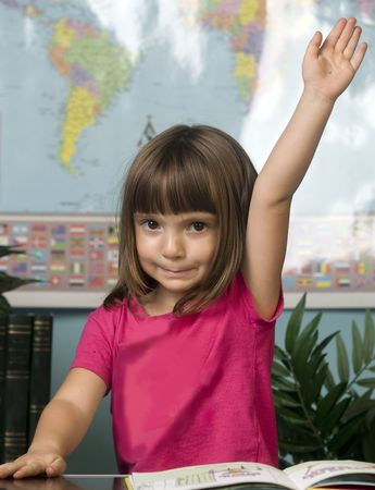 Young raising her hand to answer a question in a class toom Stock Photo - 3558793