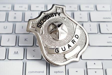 sauvegarde: Insigne de la Garde Secuity portant sur clavier d'ordinateur