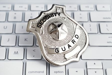 Secuity Guard Badge laying on computer keyboard Imagens