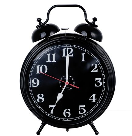 timekeeper: Old fashioned alarm clock set at 7.00am