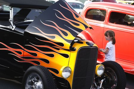 street rod: Hod Rod with flame paint job at car show