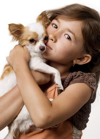 Adorable young girl holding a chihuahua photo