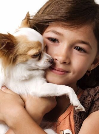 Adorable young girl holding a chihuahua Stock Photo - 4549565