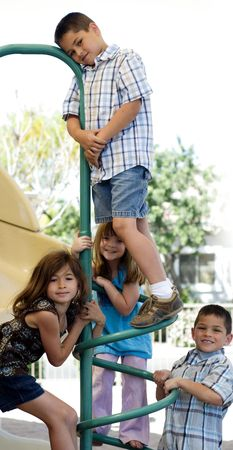 Group of young kids playing in park photo
