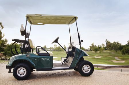 country club: Golf cart beside country club course Stock Photo
