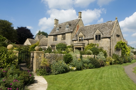 Beautiful rural Cotsworld stone homes in countryside of England photo