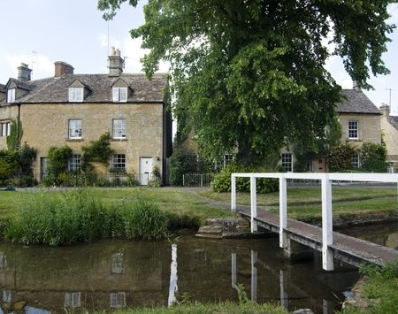Beautiful little village of lower Slaughter in the Cotswolds with stream running through it. Reklamní fotografie