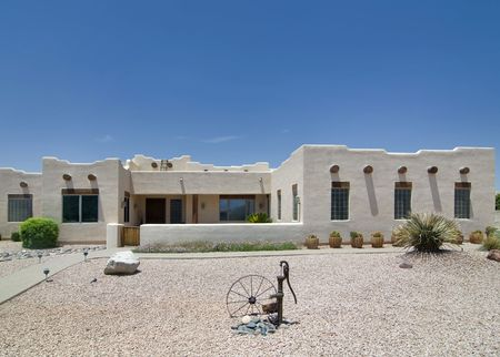 stucco house: Adobe ranch style home in Southwest USA