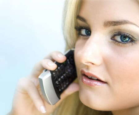 Attractive woman talking on phone Banco de Imagens