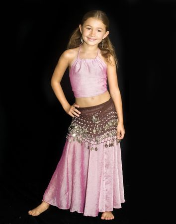 Pretty little girl wearing belly dance costume Stock Photo