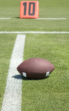 American Football field and ball on the 10 yard line photo