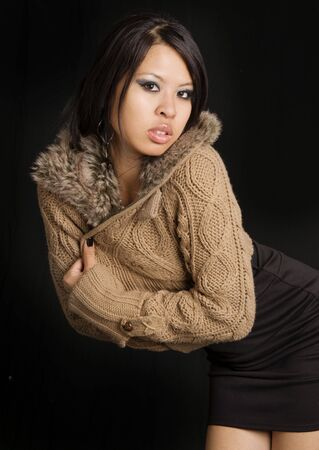 sexy asian woman: Attractive young woman wearing sweater with fur hood