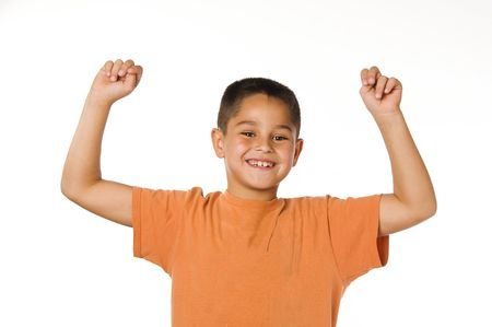 Little boy smiling and cheering with arms raised
