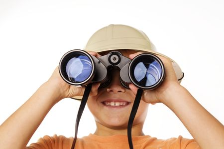 Little boy exploring looking through binoculars photo