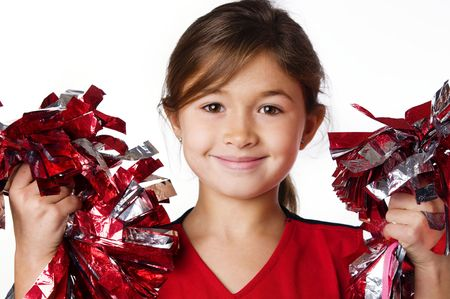 cheer:  Pretty smiling little girl cheerleader Stock Photo