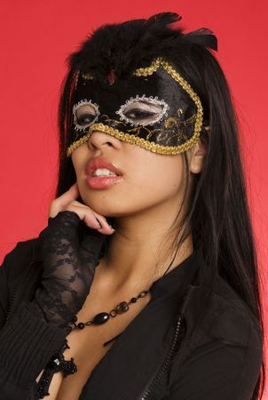 Exotic woman wearing mask photo