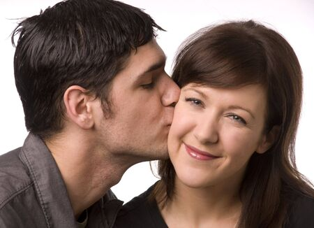 sisters sexy: Cute affectionate kiss on the cheek. Stock Photo