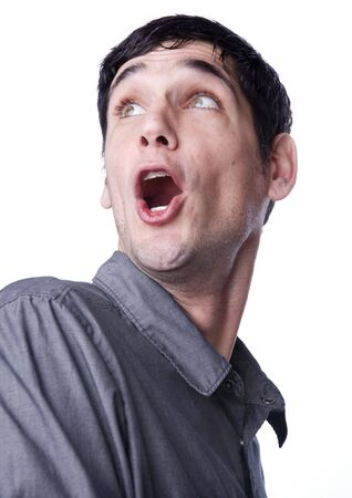 excited man:   Man looking up and behind in amazement