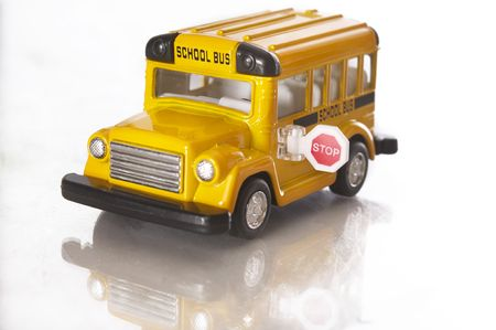 Minature model of yellow American school bus