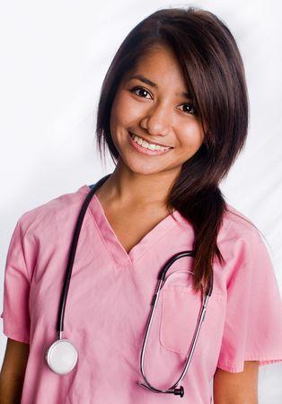minor�a:  Atractivo de Asia enfermera de permanente, con sonrisa Foto de archivo
