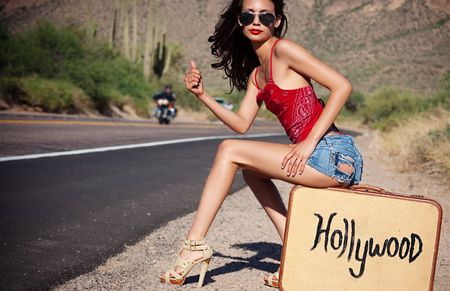 Beautiful young woman hitching a ride to Hollywood, USA