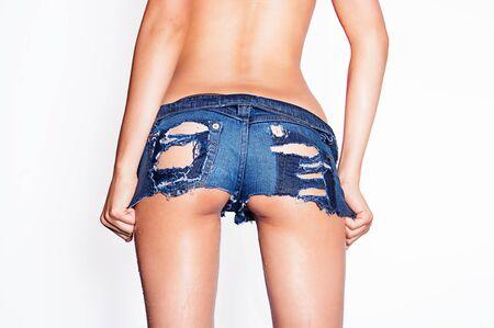 nude wet: Wet ripped tiny denim booty shorts  Stock Photo